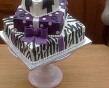 3 tier square parcel cake available in any flavours and colours.