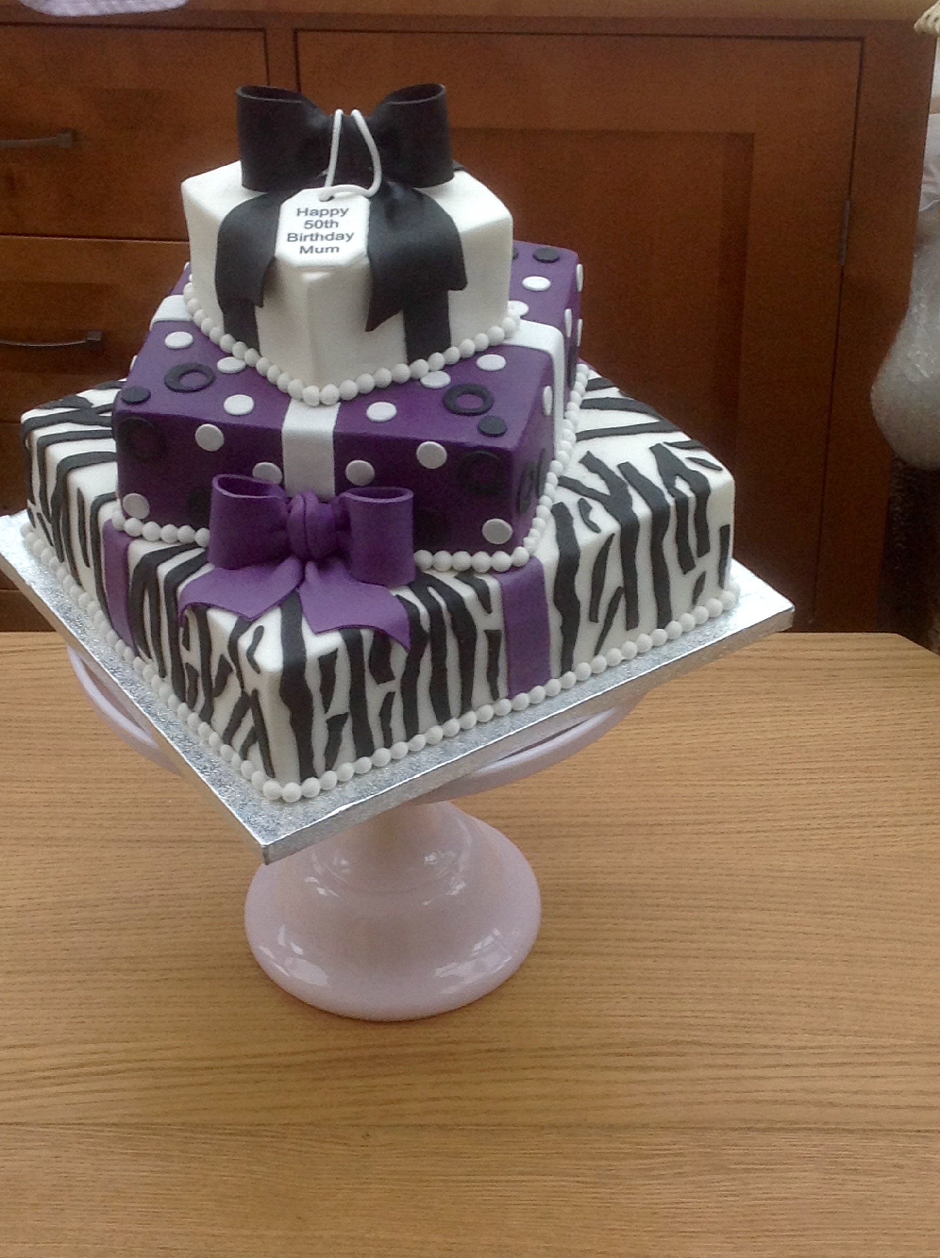 3 tier square parcel cake available in any flavours and colours ...
