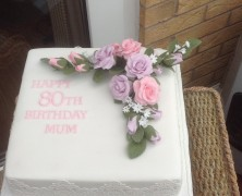8 inc square 80th birthday cake with hand made flowers.