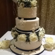 3 tier wedding cake with fresh flowers.