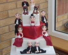 3 tier wedding cake with hand made figures